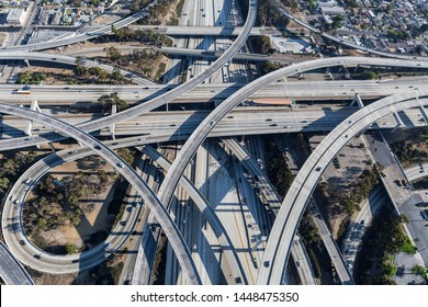 Afternoon aerial view of ramps and traffic on the Harbor 110 and Century 105 freeway junction in Los Angeles County, California.