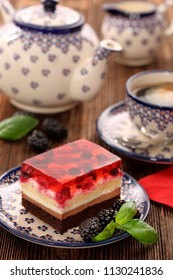 Afternoon coffee and cake with jelly and fruits on wooden background