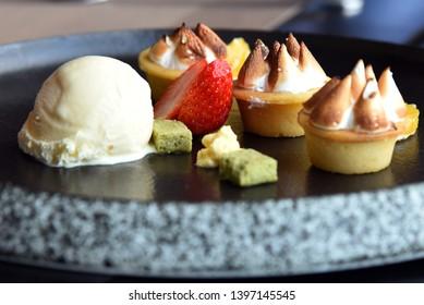 Afternoon desert, yuzu pudding, fruit and ice cream