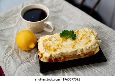 Afternoon handmade lemon Keto cake and black coffee.