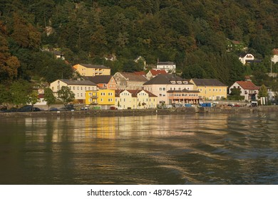Afternoon light on yellow homes in village along the Danube River near  Melk, Austria