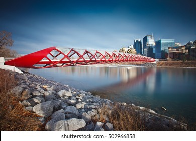 Afternoon photo of the Calgary Peace Bridge with Bow River and part of the Calgary downtown.