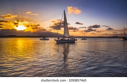 afternoon setting sun Coral sea Port Douglas sailboat reflections daintree rainforest blue sky calm sea