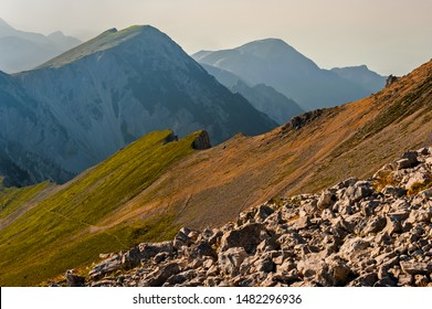Afternoon in Slovenian Alpine region, on the way to the mountain Stol where Karavanke meet Julian Alps. The land was barren, rocky, it was hot, there was haze in the air, what rendered colors unusual.