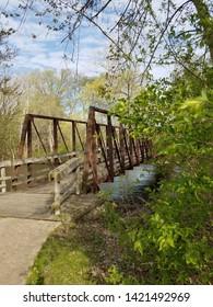 Afternoon spring walk, bridge over Huron River in Island Park, Ann Arbor, Michigan