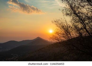 afternoon summer sunset at south italy with tree and mountains