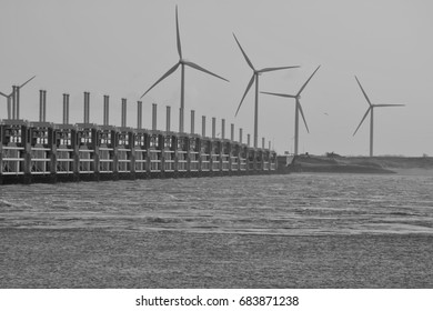 Afternoon sun on the Oosterscheldekering in black and white. Province: Zeeland, Country: Netherlands