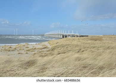 Afternoon sun on the Oosterscheldekering.   Seen from the Banjaard beach on the island Noord-Beveland.  Province: Zeeland, Country: Netherlands