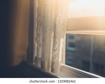 Afternoon sunlight hitting a curtain through the window