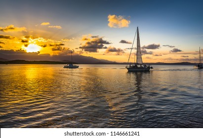 afternoon sunset cloudburst Coral sea Port Douglas Queensland calm ocean reflections Daintree background