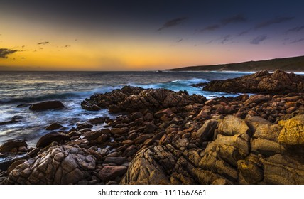 afternoon sunset rugged rocky surf coast west Australia Cape Naturaliste dramatic beach