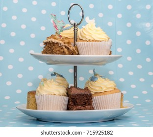 Afternoon Tea cakes on a stand on a blue background