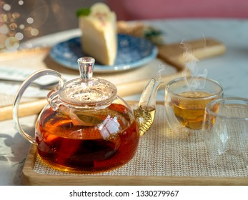 Afternoon tea in cups with teapot, teatime concepts.