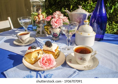 Afternoon tea in the garden served in the garden with berry cake