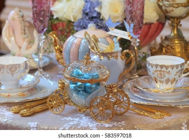 afternoon tea party with vintage gold and crystal cinderella coach,  blue vintage tea cups and pumpkin teapot