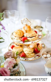 Afternoon tea of scones and jam on cake stand
