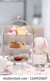 afternoon tea set. A tea time with cute unicorn macarons and a cute bunny plush doll.