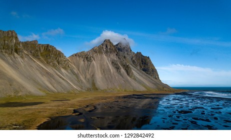 Afternoon at Vestrahorn, a 454 metre tall scree mountain, mainly made up of gabbro and granophyre rocks Stokksnes peninsula, East Iceland.