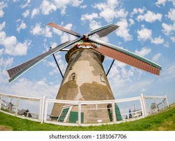 Afternoon view of Museummolen Nederwaard No. 2 in the famous Kinderdijk winmill village at Netherlands
