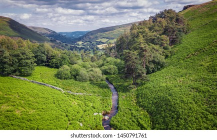 Afton Rhaeadr among fern covered hill ridge with scenic valley in background. Pistyll Raeadr in Wales, UK