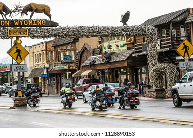 AFTON, WYOMING, USA - JUNE 5, 2015: Group of bikers passing the largest Elkhorn arch of the world in Afton, Wyoming, a gateway to the Yellowstone National Park.