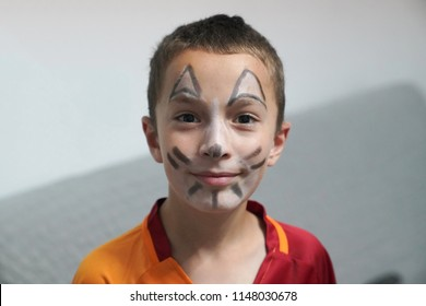 Afyonkarahisar/Turkey- July 28 2018: Boy painted as tiger or ferocious lion. Preparing for theatrical performance. Boy actor playing role. Tiger mask face