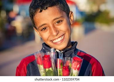 AGADIR - JAN 01: Moroccan boy-seller in a street of Agadir on January 01. 2018 in Morocco