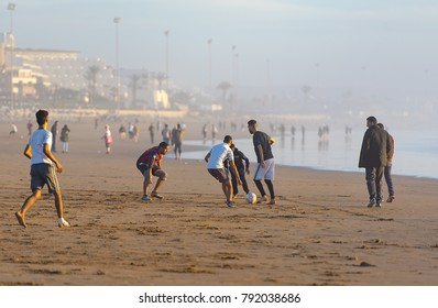 AGADIR - JAN 02: Men playing football at the beach in Agadir on January 02. 2018 in Morocco