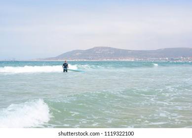 Agadir, Morocco - june 2018: surfers on the beach