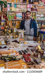 Agadir, Morocco - march 01, 2016: Shop owner inside his El Had souk, surrounded by products