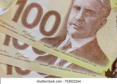 Agadir / Morocco - November 10 2017 : A stack of hundred dollar bills. Canadian dollars. Close up. Illustrative editorial.