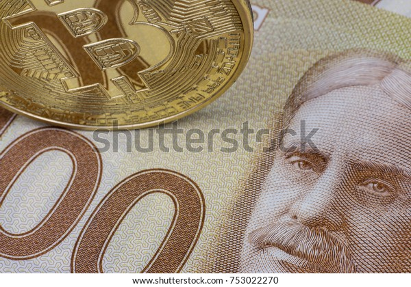 Agadir / Morocco - November 10 2017 : A hundred dollar bills. Canadian dollars. Close up.  Bitcoin. Digital Currency. Illustrative editorial.