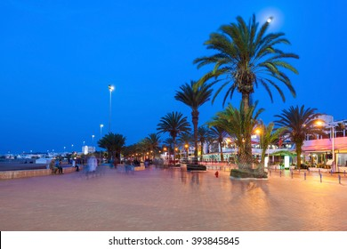 Agadir seafront promenade at the night, Morocco. Agadir is a major city in Morocco located on the shore of the Atlantic Ocean, near the Atlas Mountains.