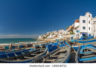Agadir, Taghazout, Morocco, North Africa, winter 2019: [Taghazout old traditional town, beach with fishing boats and hotel resorts]