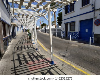 AGAETE, SPAIN - AUGUST 19, 2019: view on the street life near seaside line at summer