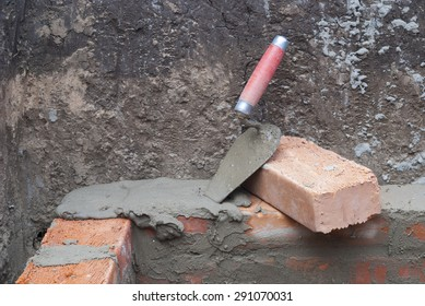 against the background of the brickwork is trowel