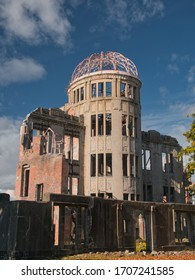 Against a blue sky with light clouds, the Genbaku Dome / Atomic Bomb Dome at the Hiroshima Peace Memorial Park in Hiroshima, Japan - originally the Hiroshima Prefectural Industrial Promotional Hall