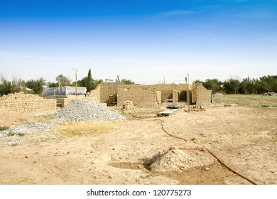 against builders building clay block house