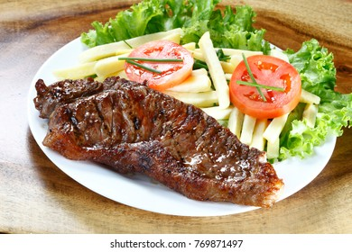 Against fillet with fries and salad