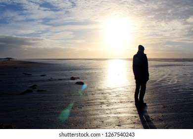 Against the light picture: Man on a north sea beach in the wadden sea, Fanoe, Denmark