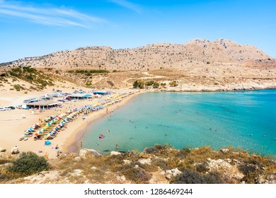 Agathi beach with holiday makers enjoying their time (Rhodes, Greece)