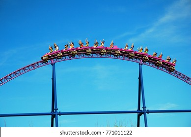 Agawam, MA, USA July 14 Riders raise their arms as they crest a hill on a roller coaster in Agawam, Massachusetts