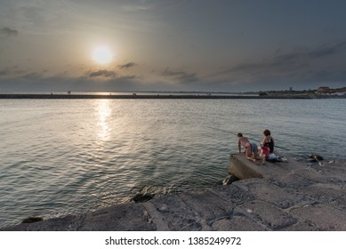 Agde, France; 08 10 2018: Fishermen in Agde at sunset in Mediterranean sea