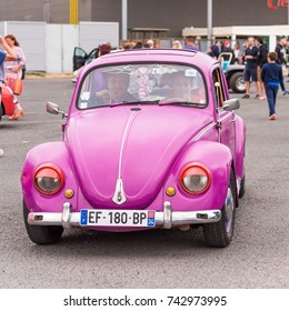 "AGDE, FRANCE - SEPTEMBER 9, 2017: Pink ""Volkswagen"" beetle was exhibited at the 16th meeting of the Volkswagen Cap d'Agde. Close-up"