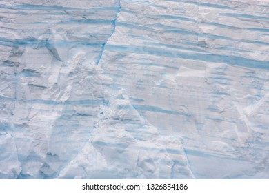age of an ice berg can be determined by the layers - each layer represents a year - ice bergs in antarctic waters near an island of Sounth Georgia