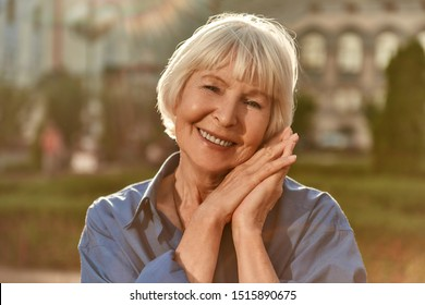 Age is just a number. Portrait of happy and beautiful senior woman looking at camera and smiling while standing outdoors on a sunny day