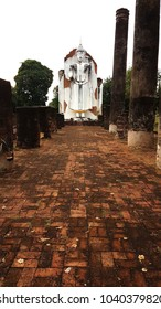 Aged abandon temple and buddha statue in Phitsanulok, the national historical place of Thailand.