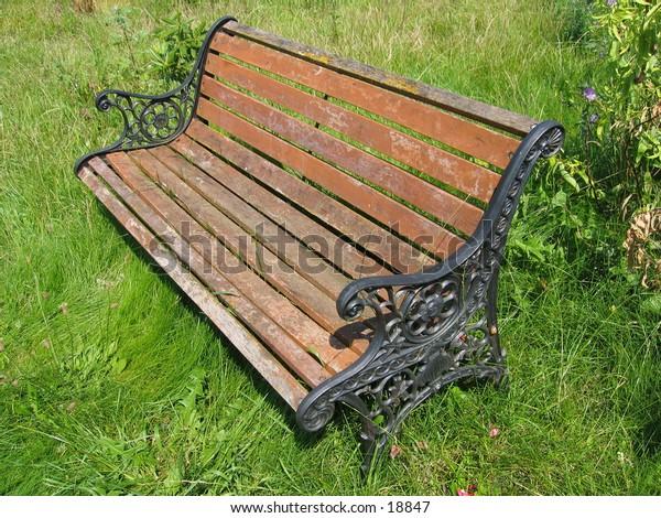Aged bench in a savaged garden.
