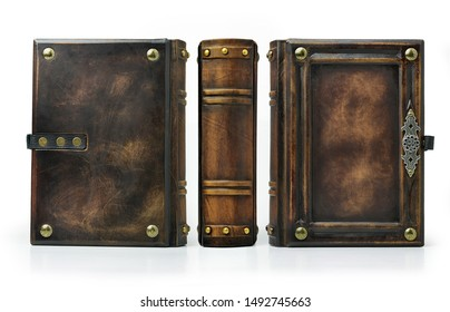 Aged brown leather book with the frame, metal pins in the corners and door handle decoration