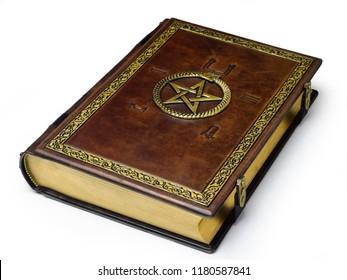 Aged brown leather book with serpent eating its own tail symbol, pentagram and embossed ancient Egypt symbols captured frontal while laying to the table from the right side.